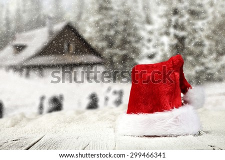 white table and red hat on  - stock photo