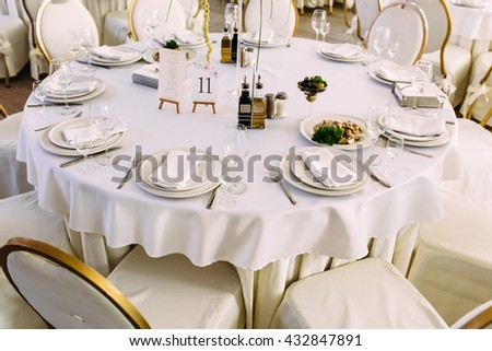 White tableclothes on the wedding tables - stock photo