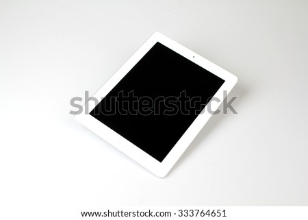 White tablet device isolated on white background - stock photo