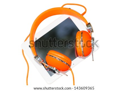 White tablet PC and orange headphones isolated on white - stock photo