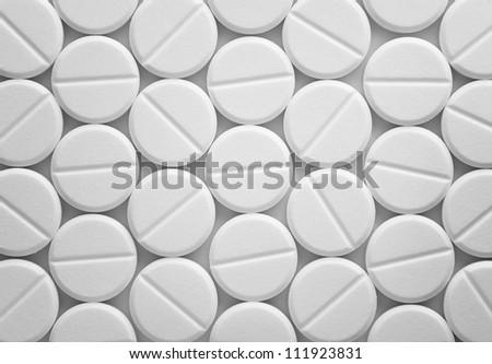 White tablet pills background - stock photo