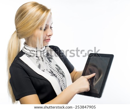 white tablet with a  blank screen in the hands on wooden table