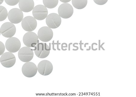 white tablets, symbolic photo for medicines, remedies and painkillers - stock photo