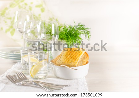 White tableware ready for dinner on the table. additional copy-s - stock photo