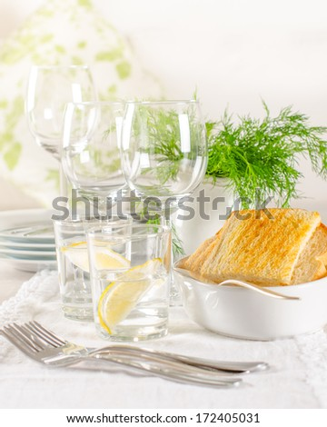 White tableware ready for dinner on the table. home decor - stock photo