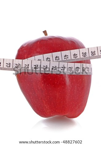 White tape measure around a red apple representing dieting