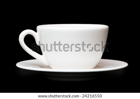 White tea cup isolated on black background