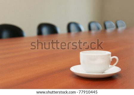 White tea cup on table - stock photo