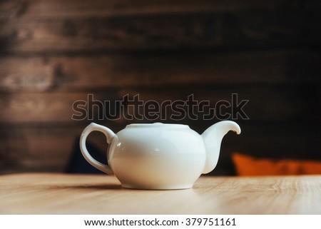 White tea on a wooden table - stock photo
