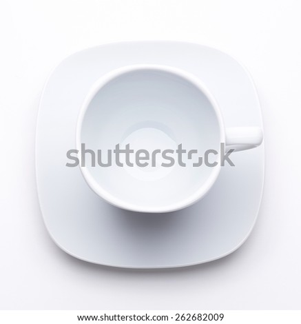 White tea or coffee cup on white saucer isolated on white. Top view - stock photo