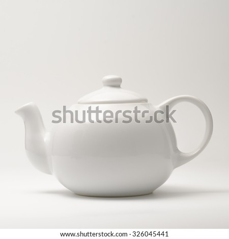 White teapot on white background