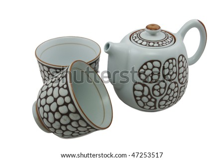 white teapot with brown ornament and two bowls isolated on white - stock photo