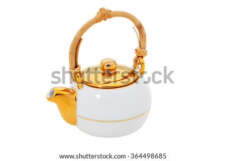 White teapot with gold and wooden handle  isolated - stock photo