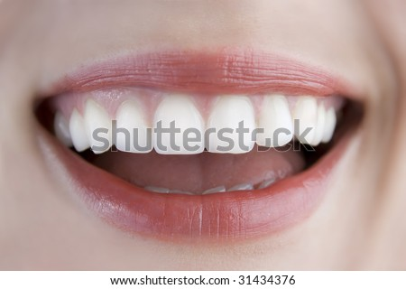 white teeth closeup, woman smiling - stock photo