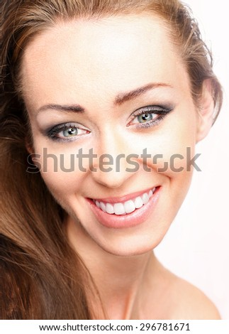 White teeth. Portrait of smiling beautiful natural women. - stock photo