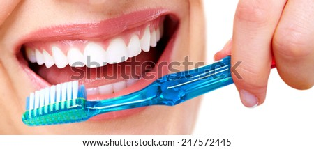 White Teeth with toothbrush. Dental health background - stock photo