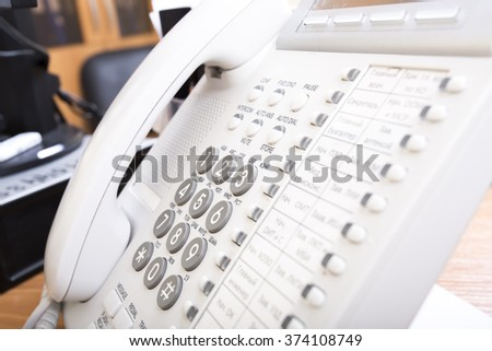 white telephone in the office of technical support - stock photo