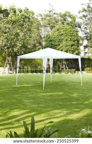 White tent in the garden - stock photo