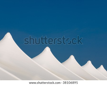 White tents and blue sky