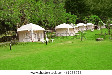 white tents on green grass - stock photo