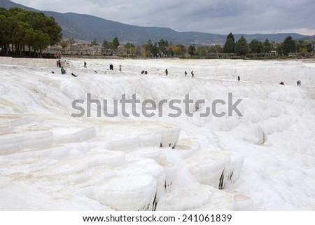 White terraces of carbonate minerals left by flowing water in Pamukkale, the World Heritage Site in Turkey. - stock photo