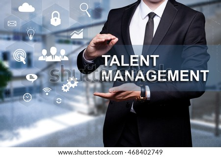 "White text with icon ""Talent Management"" in the hands of a businessman. Business concept. Internet concept."