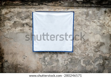 White Textile Banners on old plaster walls. - stock photo