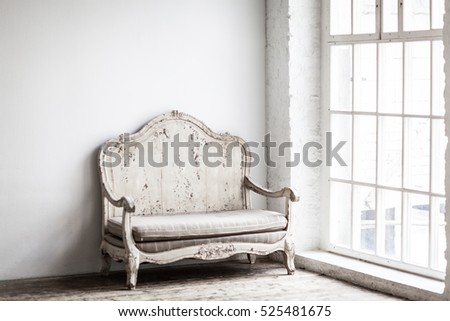 White textile classical style sofa in vintage room. White old background.