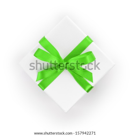 white textured gift box with green ribbon bow, from above - stock photo