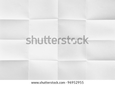white textured sheet of paper folded in sixteen - stock photo