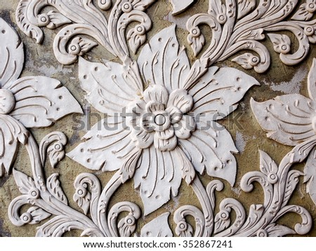 White thai art stucco wall in Thai temple  - stock photo