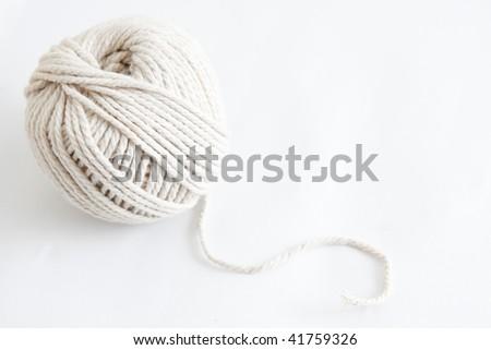 White thread on a white background - stock photo