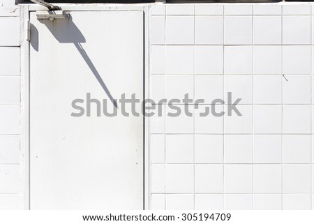 White tile and door