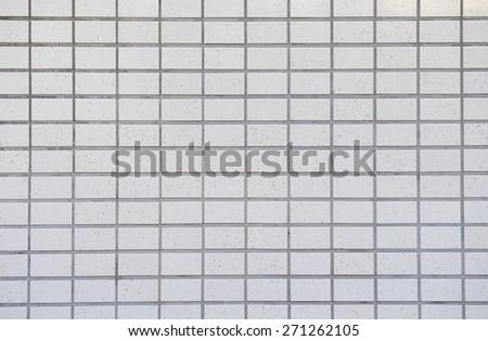 White tiled wall background - stock photo