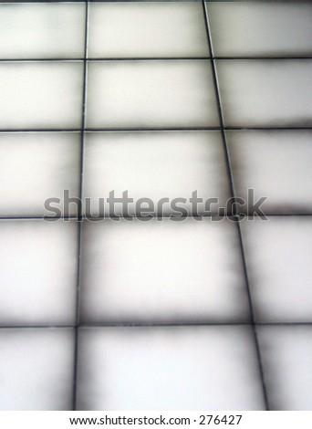 white tiles with black edges - stock photo