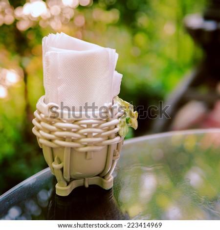 White tissue paper or napkin on table - stock photo