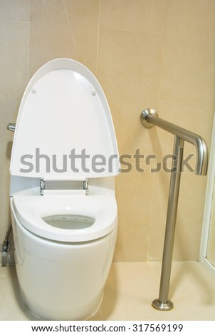 White toilet bowl in restroom