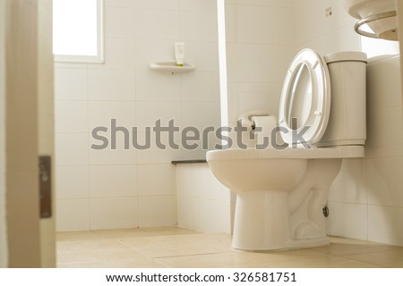 White toilet bowl in the bathroom. - stock photo