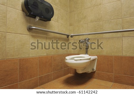 white toilet in a public restroom - stock photo