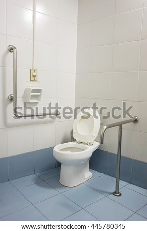 white toilet on blue ground