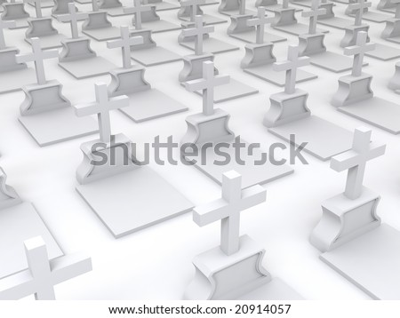 White tombstones with crosses on a cemetery