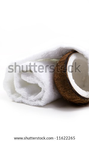 White towel and fresh coconut on white background - stock photo