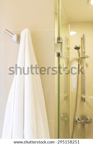 white towel hang on wall in bathroom. - stock photo