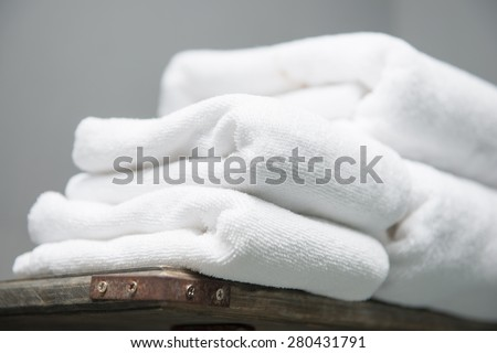 white towel placed on shelves in bathroom of hotel, fabric - stock photo