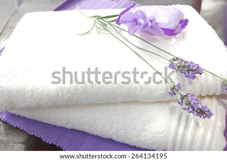White towels and lavender flowers - stock photo