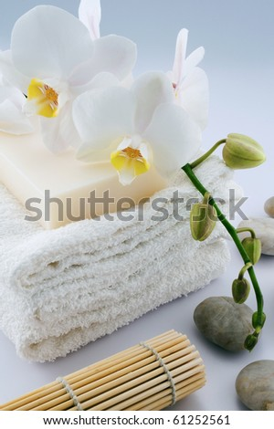 White towels and soap, orchid, bamboo on white background - stock photo