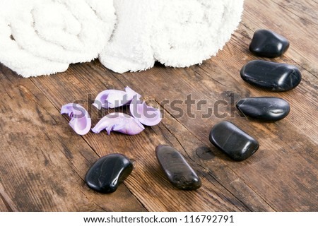 White towels and stones next to each other. - stock photo