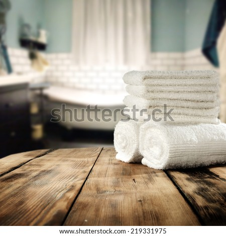 white towels in bathroom and free space on retro table for you in vintage bathroom  - stock photo