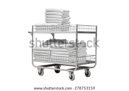 White towels on trolley of hotel isolated over white - stock photo