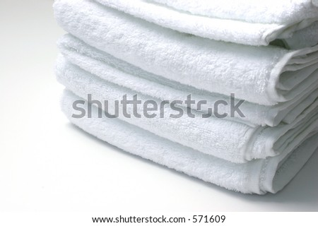 White towels over a white background.